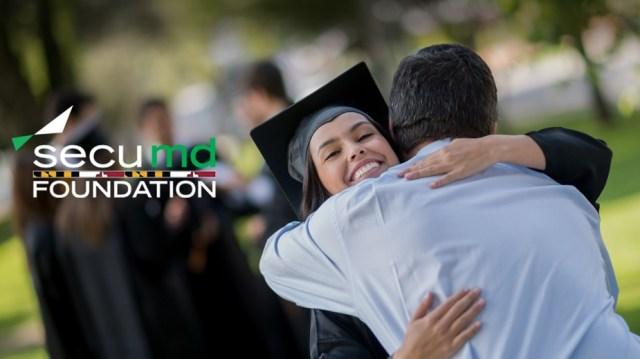 Scholar gives a hug on graduation day.